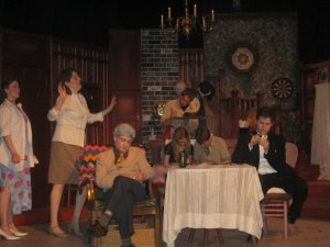 "Alumni Caroline Siede as penny plays the hostess in the play ""You can't take it with you."" The drama department put the show on in 2008. Photo provided by the Webster Groves High School Drama department."