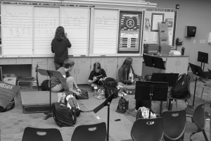 Students eat their lunches and work on homework in the band room. The entire music department hall has recently been closed to students during lunch. Photo by Bennett Durando