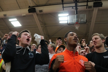 Senior Roberts Rowdies members Mick Hanrahan and Antoine Givens cheer during the men's basketball team's win over Rockwood Summit. Photo by Cullen Drissell