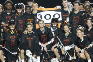 Webster Groves Chucks celebrate with John Binder have he recorded his 300th point in his high school career.