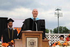 Principal Jon Clark introduce the commencement speaker.