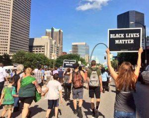 Protesters march down the streets in downtown Saint Louis on July 8. Photo by Andy Kimball