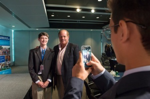 Senior Sports Editor Bennett Durando is photographed with long-time ESPN sportscaster Chris Berman. In his nervous excitement to have his picture taken with Berman, Durando doesn't notice until later that he hastily shoved part of his coat into his back pocket with his reporter's notebook before taking the picture. Photo by Maria Bryk