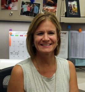 Maureen Cashel, counseling secretary, sits at her desk. Photo by Eleanor Marshall.