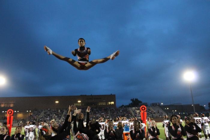 Varsity cheerleading captain senior Cianna Vo flies in the air during the Varsity football game on Aug. 26 at David H. Hickman High School vs. the Hickman Kewpies.