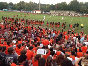 It's a sea of orange at Moss Field as Webster and Ritenour begin play on Sept. 9. Photo by Bennett Durando