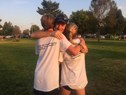 """Jack, Chris and Emily Parker share a moment at Hazelwood West Invitational at Koch Park on Friday, Sept. 23. Both Jack and Emily run cross country, and team members wore """"Team Parker T-shirts to show support for the family. Photos by Natalie Johnson"""