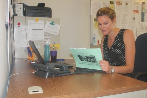 Lily Hall is seen working at her desk in room 352. Photo by Sean Mullins