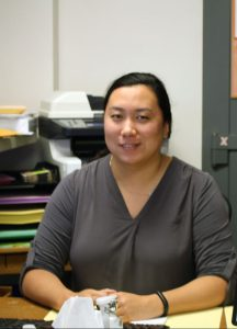 Roro Ma, bookkeeper, sits at her desk.