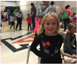 Avery student Lily Andrasko celebrates fall by getting a spider face painting at Avery's Fall Festival. Photo by Elise Keller.