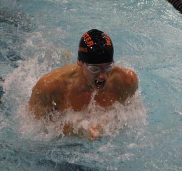 Senior Kurt Krautmann swims in the 100 -yard breaststroke at the Rockwood Summit Invitational on Oct. 6. (Photo by Andy Kimball)