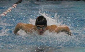Senior Michael Greaves swims during the men's 100-yard butterfly at the Rockwood Summit invitational on Oct. 6. (Photo by Andy Kimball)