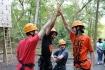 Seniors Noah Dent, Che Sanchez, David Kern and Noah Burgess high five before attempting the climbing the wall at Camp Wyman on Monday, Oct. 5.