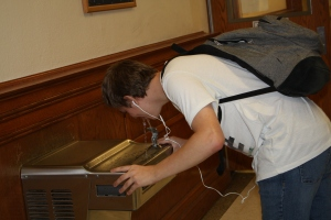 Senior David Fletcher drinks from the water fountain by the counselors' office and band hall. This water fountain ranked number one on the ECHO's list of best water fountains at WGHS. Photo by Caleb Bolin