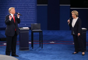 Photo by Christian Gooden/St. Louis Post-Dispatch/TNS Donald Trump and and Hillary Clinton on stage during the second debate between the Republican and Democratic presidential candidates on Sunday, Oct. 9, 2016 at Washington University in St. Louis, Mo.