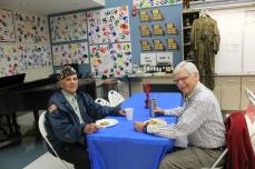 Veterans Don Green and Don McDaniels eat breakfast prepared by child development teacher Diane Stromberg and tell stories of past battles. Photo by Ashli Wagner