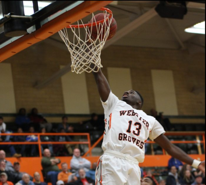 Junior Courtney Ramey dunks in the Webster Classic first round victory against Marquette. Ramey put up 26 points in an amazing half to start the season. Photo by Andy Kimball