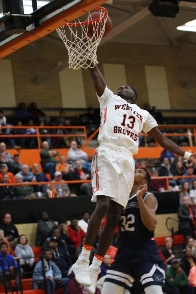 Junior Courtney Ramey shoots a layup in the Statesmen's season opening win over Marquette. Ramey led the way with 28 points. (Photo by Andy Kimball