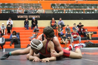 Webster took a victory over McCluer from the help of JV wrestler sophomore Sam Vandergriff pinning a McCluer wrestler at Roberts Gym on Monday Dec 5. Photo by Greg Frazier.