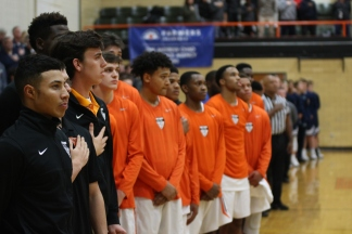 The Statesmen stand for the national anthem before their game versus Marquette. (Photo by Andy Kimball)