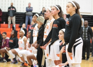 While some women's basketball players stand for the national anthem, others kneel as a protest against racial inequality in the United States. Photo by Bennett Durando