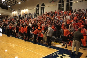 The Webster bench and student section go berserk after an alley-oop in a 59-43 win at SLUH. Photo by Andy Kimball