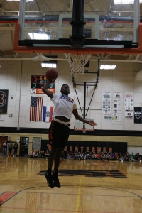 Junior Courtney Ramey shoots a basket at the Winter Sports Assembly on Friday, Jan. 20. Photo by Page Kimzey