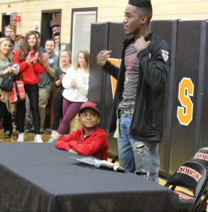 Junior Courtney Ramey commits to the University of Louisville. Ramey's younger brother helped him with the commitment. Photo by Andy Kimball.