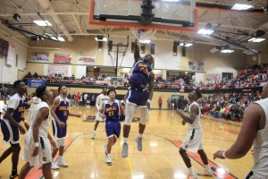 Junior Carte'Are Gordon throws down a dunk in last night's 71-62 win over Pattonville. Photo by Andy Kimball