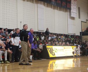 Head coach Jay Blossom was back on the sideline for the first time in over a month in last night's 71-62 win over Pattonville. Assistant Scott Stallcup (in purple) was 11-0 as interim HC. Photo by Andy Kimball