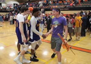 Dressed in Douglas High purple and yellow, Webster players greet their supporters after last night's 71-62 senior night win over Pattonville. Photo by Andy Kimball