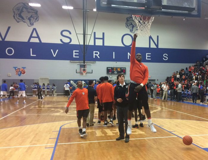 Statesmen are about to tip off against Vashon. Seven division one level players played tonight: three for Webster and four for Vashon. Photo by Bennett Durando