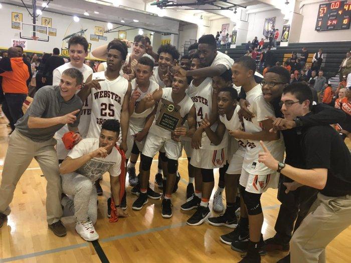 Statesmen basketball celebrate winning the District championship. The team defeated Vianney 57-41 tonight. Photo by Bennett Durando