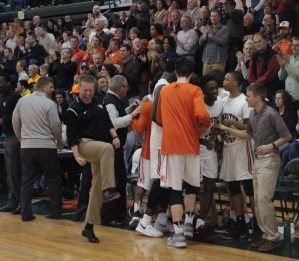 After the Webster starters sub out, head coach Jay Blossom and the bench celebrate the District title. Photo by Andy Kimball