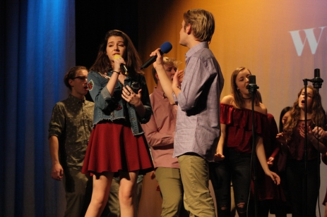 "Juniors Rachel Fisher and Nicholas Braun duet during ""With and/or Without You"" on Dec. 8, in the auditorium. Photo by Caroline Fellows"