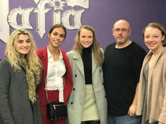 Seniors Anna Bussler, Claire Puricelli, Katie Winkelmann and Aubry Buckman are accompanied by owner of Metal Mafia, Dale Parris, after being awarded $200 for their winning jewelry line. Photo by Karen Verstrate