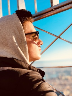 Senior Sam James peers from the Empire State Building overlooking the city. Photo by Britney Clark